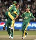 JP Duminy is lifted by Johan van der Wath after he ran out Shakib Al Hasan