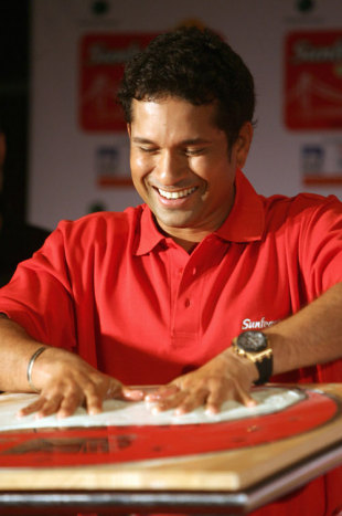 Sachin Tendulkar places his hands on a plaster bed to make promotional prints, Kolkata, September 18, 2007