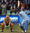 Mahendra Singh Dhoni prepares to loft a delivery for six