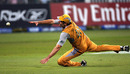 Michael Hussey makes a despairing dive for the ball