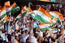Indian fans celebrate as their team push the pedal
