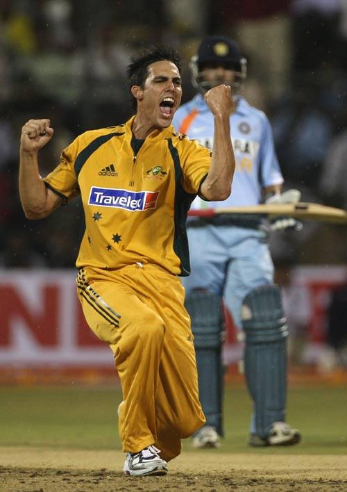 Mitchell Johnson celebrates after dismissing Sachin Tendulkar for a Duck