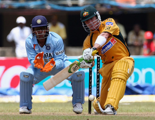 Brad Haddin prepares to launch into the ball during his unbeaten 87