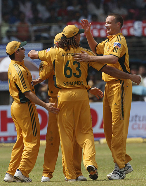 StuartClark celebrates the dismissal of Robin Uthappa