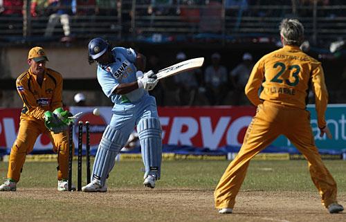 Ramesh Powar is bowled by Michael Clarke