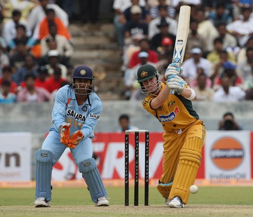 Michael Clarke drives down the ground while Mahendra Singh Dhoni looks on, India v Australia, 3rd ODI, Hyderabad, October 5, 2007