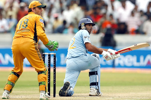 Yuvraj Singh sweeps the ball square while Adam Gilchrist looks on, India v Australia, 3rd ODI, Hyderabad, October 5, 2007