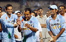 Mahendra Singh Dhoni and Irfan Pathan spray cola on Man-of-the-Match Murali Kartik