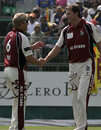 Glenn McGrath and Shane Warne shake hands during the Hong Kong Cricket Sixes, Kowloon Cricket Club, October 27, 2007