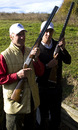 Chris and Stuart Broad pose with shotguns