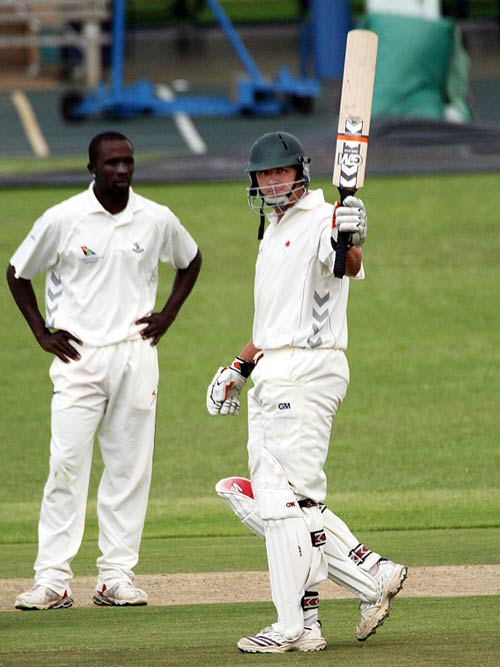 Shaun Liebisch raises his bat on reaching his fifty