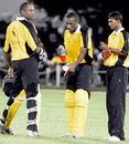 Floyd Reifer (left) and Nekoli Parris (centre) getting assistance from 12th man Ramnarine Chattergoon during their match-winning third-wicket stand of 150,  Sagicor Super Cup final, Barbados, November 3, 2007
