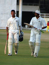 Cheteshwar Pujara and Rakesh Dhurv leave the field