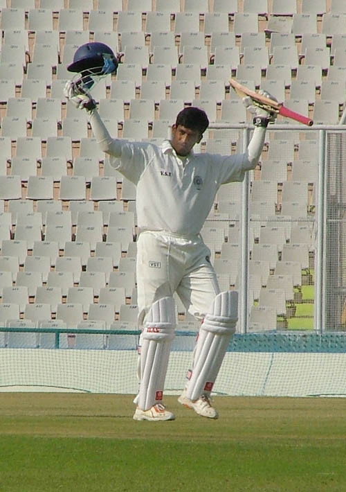 Daniel Manohar celebrates his eighth first-class hundred
