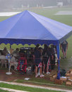 England shelter under a tent as the rain hammers down at Colombo, Sri Lanka Cricket Board President's XI v England XI, Colombo, November 20, 2007