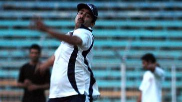 Manoj Prabhakar, Delhi's bowling coach, tries his luck with the cherry
