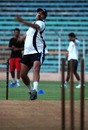 Manoj Prabhakar, Delhi's bowling coach, tries his luck with the cherry