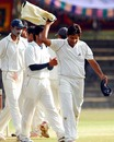 Mohammad Aslam leads his team off the field after Karnataka were bowled out for 329, Karnataka v Rajasthan, Ranji Trophy Super League, Group A, 4th round, 3rd day, Mysore, December 3, 2007