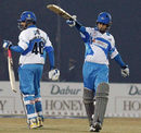 Monish Mishra signals his fifty, Delhi Jets v Kolkata Tigers, 10th match, Indian Cricket League, Panchkula, December 8, 2007