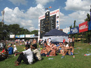 Fans relax on the grass embankment near the giant scoreboard, Sri Lanka v England, 2nd Test, Colombo, 2nd day, December 10, 2007