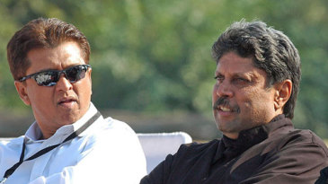 Kiran More and Kapil Dev watch the play-off for fifth place