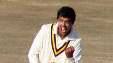 Vishal Bhatia exults after claiming a wicket