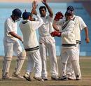 Ashraf Makda with his team-mates after dismissing Rahul Bakshi, Gujarat v Madhya Pradesh, Ranji Trophy Plate League, 1st semi-final, 2nd day, Delhi, December 26, 2007