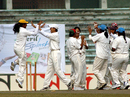 The Khulna women celebrate the fall of a Rajshahi wicket