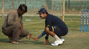 Delhi's bowling coach Manoj Prabhakar scrutinises the pitch, Indore, January 4, 2008