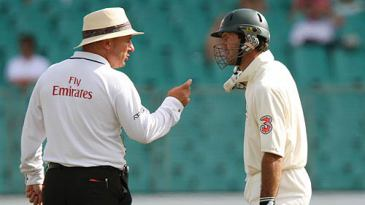 Ricky Ponting and the umpire Mark Benson exchange words