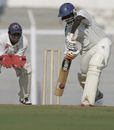 Harshad Rawle defends the ball as Parthiv Patel looks on, Gujarat v Railways, Ranji Trophy Plate League Final, Mumbai, 1st day, January 5, 2008