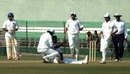 Delhi's Parvinder Awana is congratulated on the wicket of Shatrunjay Gaekwad