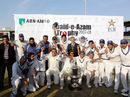 The Sui Northern Gas Pipelines Limited team pose with the Quaid-e-Azam Trophy