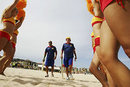 Adam Hollioake and John Emburey, sporting a fetching yellow hat, walk through the legs of honour, Beach Cricket Tri-Nations series, Maroubra Beach, Sydney, January 12, 2008