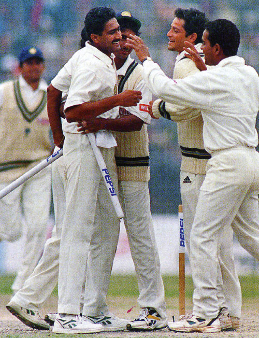Ten and done: Kumble takes the last Pakistan wicket, and the stumps for a keepsake