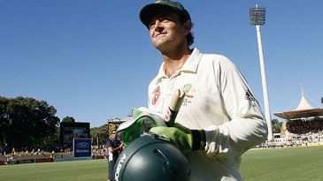 Adam Gilchrist, souvenir stump in hand, leaves Test cricket behind