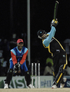 Cletus Mathurin powers the ball down the ground during his 47-ball 39, Cayman Islands v St Lucia, 2nd match, Stanford 20/20, Antigua, January 26, 2008