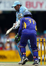 Mahendra Singh Dhoni tries to tap one down to fine leg