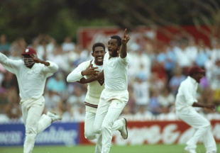 A jubilant Courtney Walsh celebrates the narrowest of victories