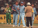 Alec Stewart steps in to prevent any argument between Phil Tufnell and umpire Tony McQuillan, Australia v England, MCG, December 13, 1994