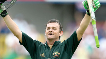 Adam Gilchrist, arms outstretched, celebrates his 16th ODI hundred