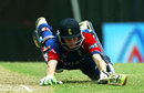Liam Dawson dives to make the crease