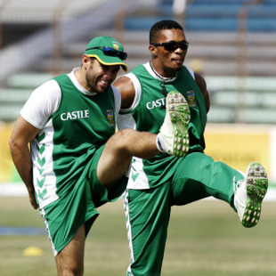 Neil McKenzie and Makhaya Ntini do a few warm-up exercises, Chittagong, February 28, 2008