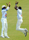 Pedro Collins celebrates another wicket with Kevin Stoute