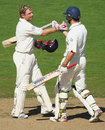 Double hundreds ...Ian Bell is congratulated by Andrew Strauss on reaching his century