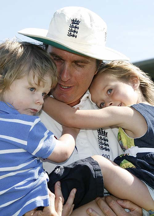 Michael Vaughan meets his children after the end of a long tour