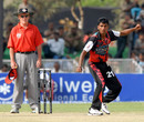 Upul Chandana bowls while umpire Jeff Evans keeps close watch, Delhi Giants v Kolkata Tigers, Indian Cricket League, Gurgaon, March 30, 2008