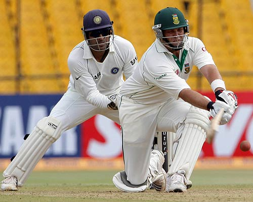 Jacques Kallis sets himself up to sweep Harbhajan Singh