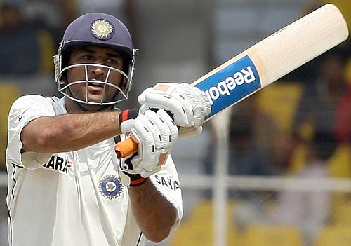 Dhoni using new rbk stickers 89125
