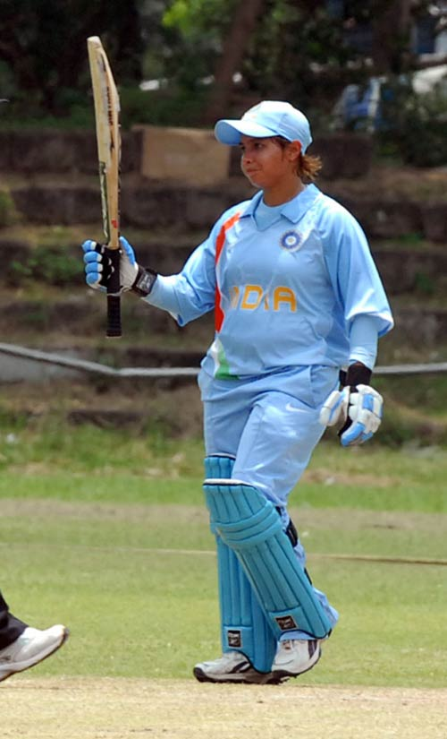 Jaya Sharma raises her bat after crossing fifty